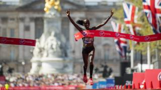 Vivian Cheruiyot of Kenya celebrates after crossing the finish line