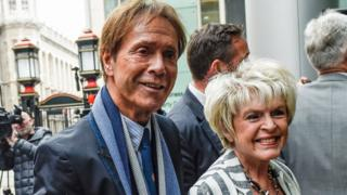Sir Cliff Richard arriving at the High Court with Gloria Hunniford on 13 April 2018