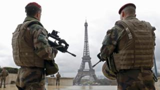 French paratroopers patrol near the Eiffel Tower in Paris (March 2016 picture)