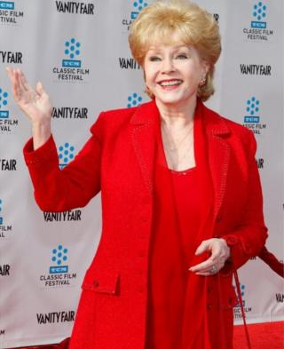 """Actress Debbie Reynolds arrives at the world premiere of the 40th anniversary restoration of the film """"Cabaret"""" during the opening night gala of the 2012 TCM Classic Film Festival in Hollywood, California April 12, 2012"""