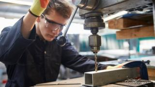 Apprentice in steel fabrication factory