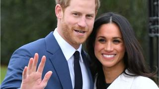 Meghan Markle and Prince Harry pose after engagement