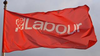 The Labour flag flies outside the Brighton Center ahead of the Labour Party Autumn Conference