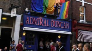 Gay rainbow flag outside Admiral Duncan pub in Old Compton Street,
