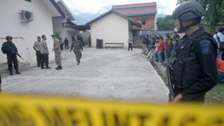 Indonesian police stand guard at a local hospital in Palu, Central Sulawesi province, on July 19, 2016, after a firefight between suspected Muslim extremists and security forces in the nearby village of Tambarana the day before
