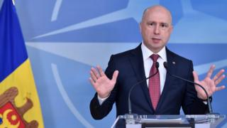Moldova's Prime Minister Pavel Filip gives a joint statement with Nato Secretary General Jens Stoltenberg after a meeting at NATO Headquarters in Brussels