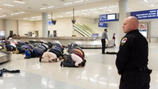 People gather to pray in baggage claim during a protest against the travel ban imposed by U.S. President Donald Trump's executive order, at Dallas/Fort Worth International Airport in Dallas, Texas, U.S. on January 29, 2017