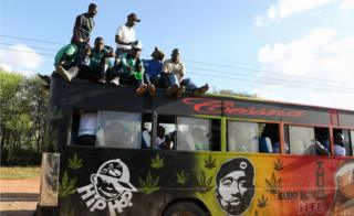 Fans of Kenyan club Gor Mahia cheer on top of a matatu after their team played against during Tunisian club Esperance during the CAF Champions League first round match between Gor Mahia and Esperance Tunis, in Machakos, Kenya, 07 March 2018.