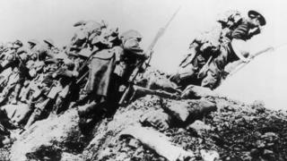 British troops climbing from their trench on the first day of 'The Big Push' on the Somme during World War One