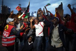 """upporters of the incumbent President and the leader of the ruling Jubilee coalition Uhuru Kenyatta cheer as they wait for the electoral body to announce Kenyatta""""s victory, in downtown Nairobi, Kenya, 11 August 2017. The electoral body Independent Electoral and Boundaries Commission (IEBC) is expected to announce the winner of the presidential poll soon where Kenyatta will beat opposition Raila Odinga by a big margin."""