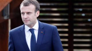 Emmanuel Macron arriving at an interview