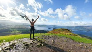 Woman overlooking Loch Lomond