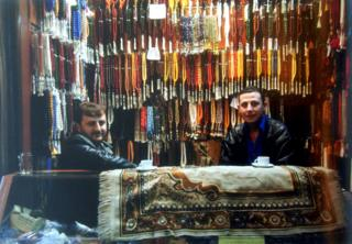 Bead sellers at the souk, before the war