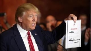 Trump holds signed pledge