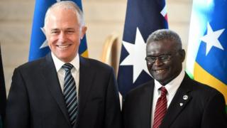 Malcolm Turnbull and Manasseh Sogavare appear before cameras in Canberra on Monday