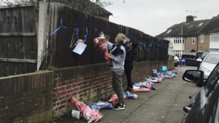 Friends and family of Henry Vincent tie tributes to a fence