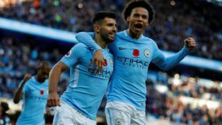 Sergio Aguero and Leroy Sane of Manchester City