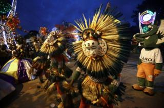 Dancers in costumes perform at a festival