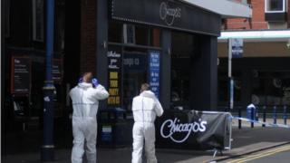 Investigators remain at the scene