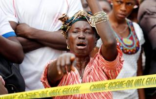 A mother who lost her son during the mudslide reacts near the entrance of Connaught Hospital in Freetown, Sierra Leone August 16, 2017.