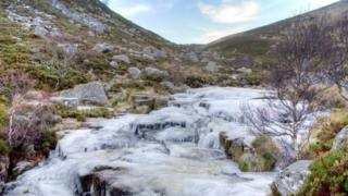 Frozen waterfall at the end of Loch Muick near Ballater