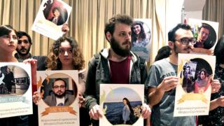Students show posters of detained colleagues