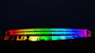 A rainbow of coloured light projected onto the main GCHQ building