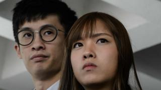 In his file photo taken on 30 November 2016 shows pro-independence lawmakers Baggio Leung (L) and Yau Wai-ching speaking to the press outside the High Court in Hong Kong.