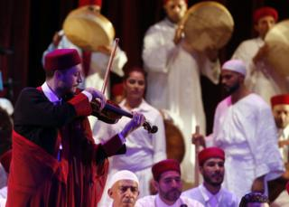 Tunisian members of the group El Hadhra Chants Soufis perform during the Festival de La Medina at the Municipal Theater in Tunis, Tunisia, 06 June 2017