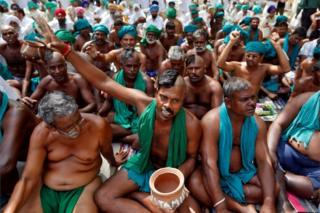 Farmers from the southern state of Tamil Nadu pose half shaved during a protest demanding a drought-relief package from the federal government, in New Delhi, India April 3, 2017