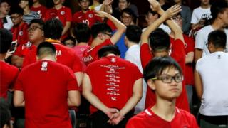 Hong Kong fans turn their backs as the Chinese national anthem is played at a match against Malaysia, 1 November 2017