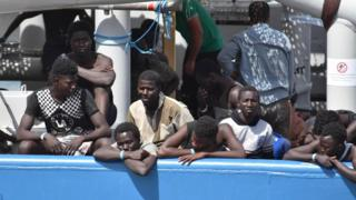 Some of the 650 migrants who were rescued by the Swedish ship Frontex in Mediterranean Sea off the Libyan coast, wait to disembark in Catania, Italy, 01 July 2017