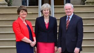 Theresa May is welcomed at Stormont Castle by Northern Ireland's first and deputy first ministers