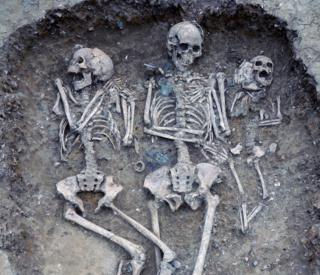 This triple burial from Oakington, Cambridgeshire, including metal and amber grave goods with continental European characteristics.