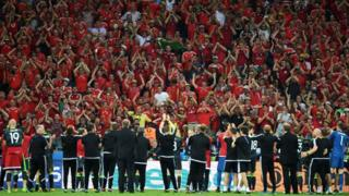 Wales fans applaud the team after their defeat to Portugal