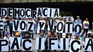 Opposition activists protest in Caracas
