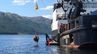 One of the bombs is lifted from the loch