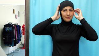 Australian model Mecca Laalaa wearing an Islamic swimsuit (or burkini)