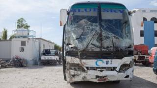 View of the bus that lost control and drove into members of a band, according to local relief officials, is impounded at a police station for further investigation, in Gonaives, north of Haiti, 12 March 2017