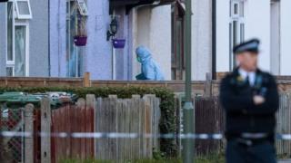 A forensic officer enters a property on Cavendish Road during a raid in connection with the terror attack at Parsons Green station