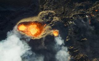 An impressive aerial view above an erupting volcano on Reunion Island