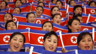 North Korean cheer team members wave their national flags during the World Students Games opening ceremony in Daegu on 21 August 2003.