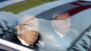 Fifa President Sepp Blatter (left) and his lawyer Lorenz Erni (right) arrive in a car at the Fifa headquarters in Zurich (17 December 2015)
