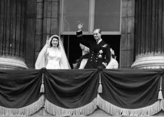 Princess Elizabeth and the Duke of Edinburgh on the balcony of Buckingham Palace