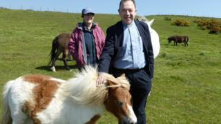 Father Edward Owen meets Barney the Shetland pony