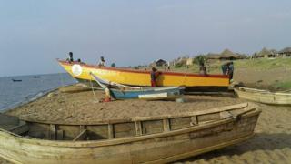 The ill-fated yellow boat is brought back ashore from Lake Albert