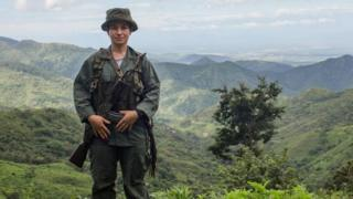A FARC female guerrilla on guard during the days prior to their demobilization, 7 Dec 16