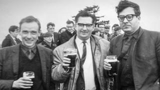 """Architects John Cowell (l) and Isi Metzstein (r) - and project manager Stan Blair in the centre - celebrate at the """"topping out"""" ceremony in 1965"""