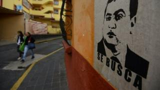 "Women walk by a poster depicting outgoing Veracruz Governor Javier Duarte with the word ""Wanted"" at a neighbourhood in Xalapa, Mexico, October 25, 2016."