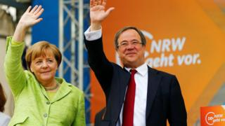 CDU candidate Armin Laschet and German Chancellor Angela Merkel attend an election rally in Aachen, Germany, May 13, 2017